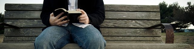 reading-the-bible-on-bench